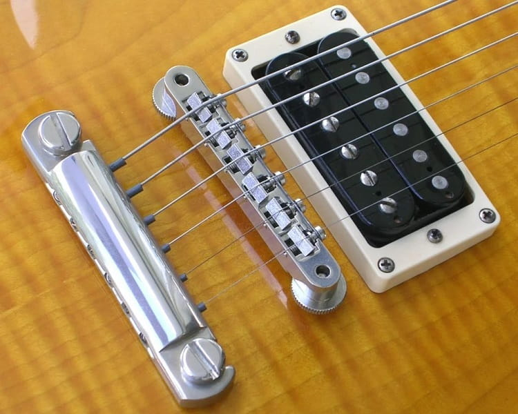 The Fixed Electric Guitar Bridge